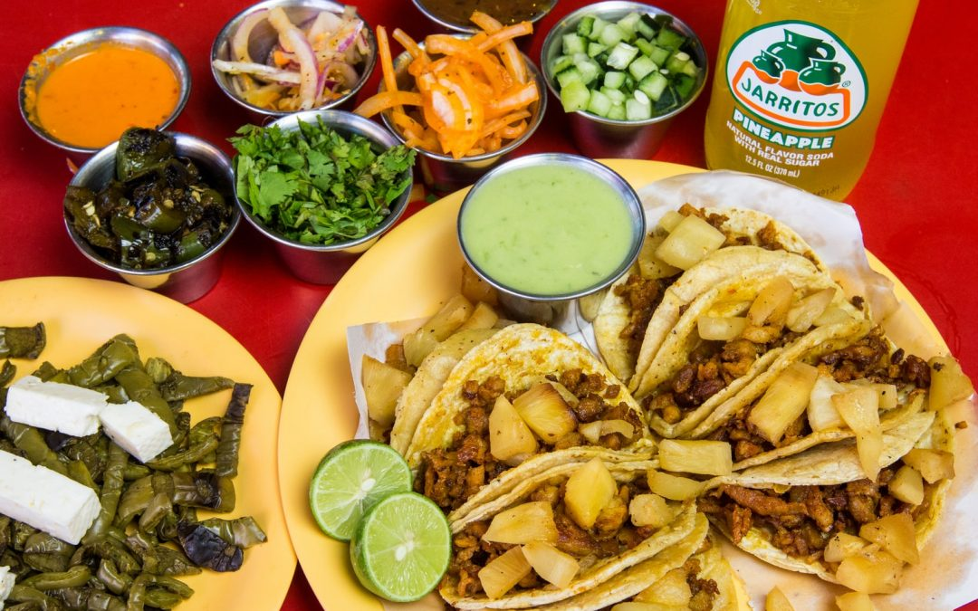 Mexican Food Dishes with Sauces and a Mexican Soda